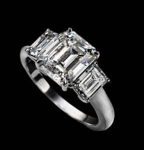 09 Carat Three Stone Emerald Cut Diamond Ring H