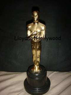 OSCAR LIKE TROPHY STATUE PLASTIC GOLD COLORED MALE FIGURE HOLDING