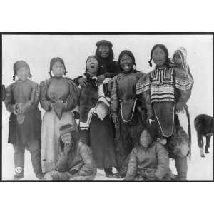 Group of 9 Eskimos,smiling,traditional dress,c1913,snow