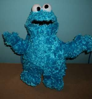 Sesame Street Cookie Monster plush doll backpack.