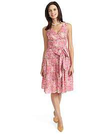 Sleeveless wrap dress made of cotton. Features a print from Liberty
